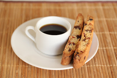 photo of a cup of coffee with biscotti