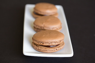 close-up photo of a chocolate macaron