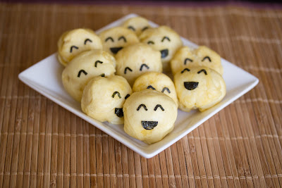 photo of a plate of steamed buns with happy faces