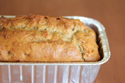 close-up photo of a loaf of banana nut bread in a baking pan