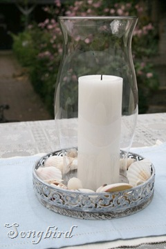 Candle with shells