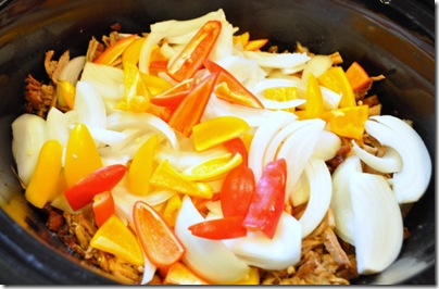 Onions and peppers on pulled pork for fajitas