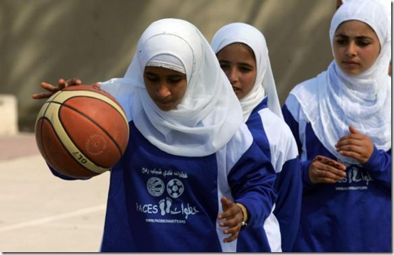 Palestinian girls play basketball at the Rafah Youth Club in Gaza on
