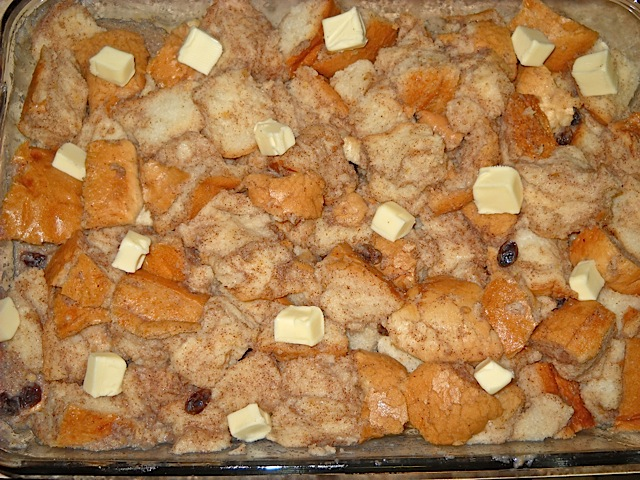 unbaked bread pudding in glass pan