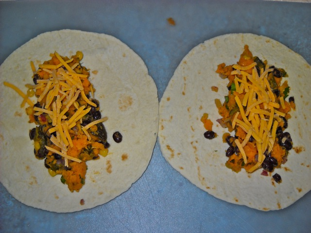 tortillas filled with sweet potato mixture and cheese