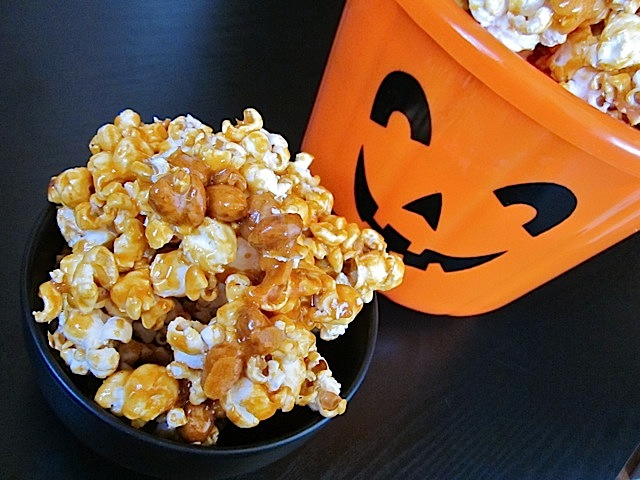 nutty caramel corn in bowl with pumpkin decorative bowl next to it