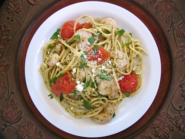 plate of pesto shrimp pasta with  parmesan on top