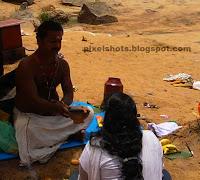 papanasham beach photos,hindu rituals done in sacred beach of varkala named as papanasham,baliidal for dead souls by hindu believers