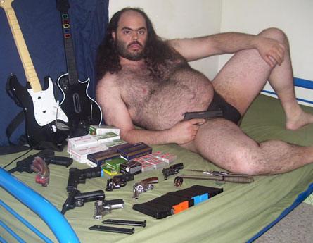 weird-guy-with-guns.jpg