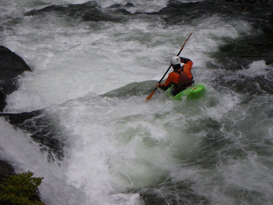 Chris finishing the rapid with a sweet 8' boof