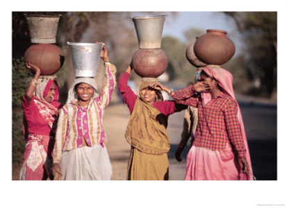 women carrying water pitchers on their head