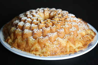 photo of a Coconut Mochi cake dusted with powdered sugar