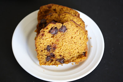 overhead photo of slices of Chocolate chip pumpkin bread on a plate