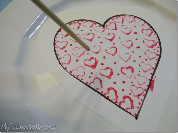 use the tip of a paintbrush for making perfect painted dots on glass