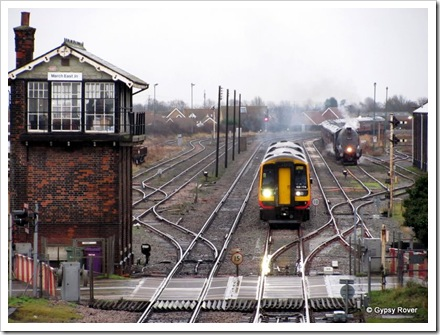 Class 158 en route to Liverpool Lime St passes Sir Nigel Gresley at March sidings.