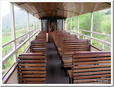 Open air carriage on the Welsh Highland railway for avid photographers. Not many today.