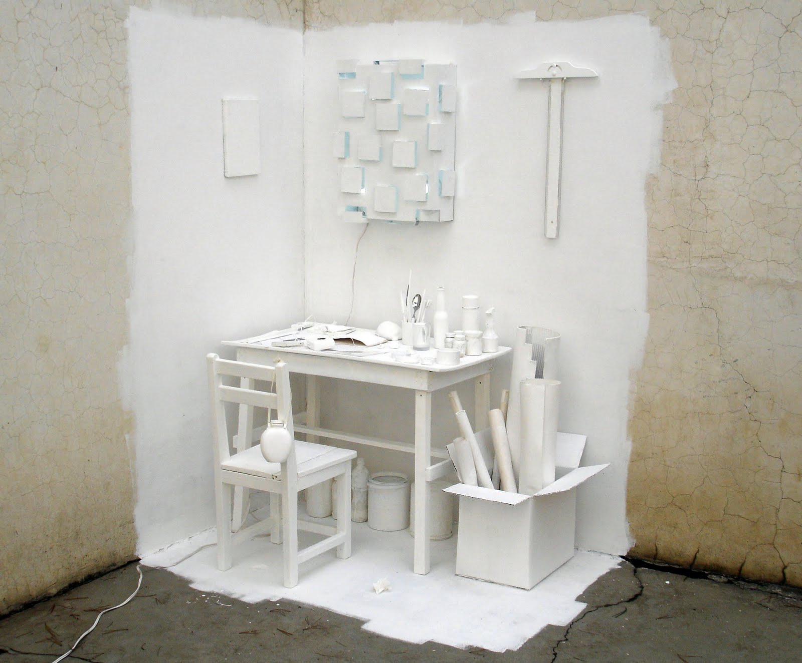 Installation with furniture and white paint