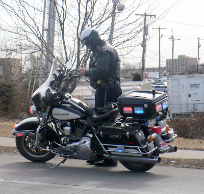 Motorcycle Policeman Making Someone Very Happy, 2/2/09, Olathe, KS.