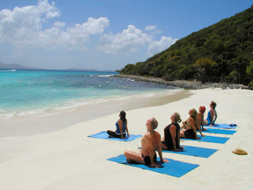 beach-yoga-SeaDream - Whether you're a yoga veteran or newcomer, join in a refreshing yoga instruction on a beach during your SeaDream voyage.