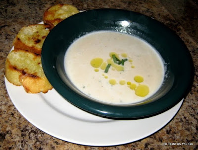 Tuscan White Bean and Garlic Soup with Grilled Baguette Slices - Photo by Taste As You Go