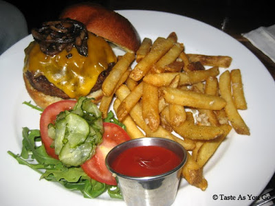 Common Burger with Cheddar, Tomato, Rocket, Sautéed Onions, Mushrooms, and Herbed Aioli, Served with Garlic French Fries at West 3rd Common in New York, NY - Photo by Taste As You Go