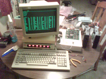 Computer Terminal, bare PCBs and unhoused floppy drives running rampant on the kitchen table.