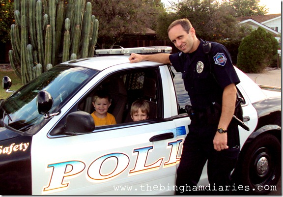 boys in police car