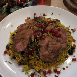 Pan Roasted Duck Breast On Saffron Rice With Pomegranate, Orange And Pistachios