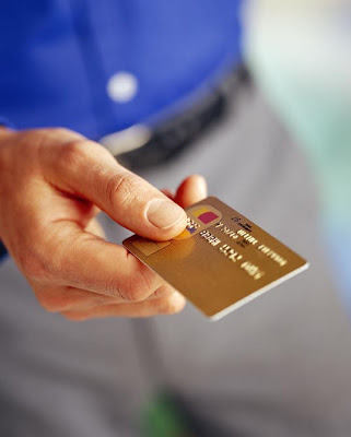 closeup of a credit card in a man's hand