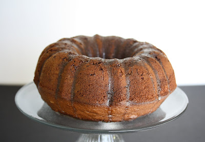 photo of an irish cream bundt cake on a cake stand