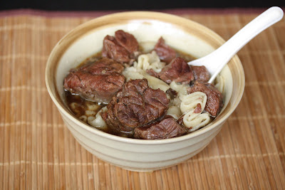 Beef noodle soup in a bowl with a spoon