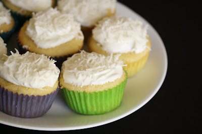close-up photo of a plate of coconut cupcakes