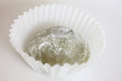 close-up photo of a piece of mochi in a cupcake liner
