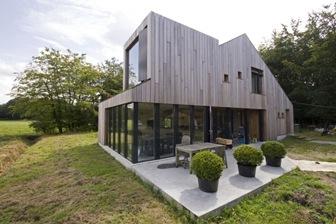 Fachada-casa-de-Madera-casa-moderna-bosschenhoofd