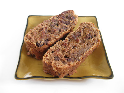 photo of two slices of chocolate banana nut bread on a plate