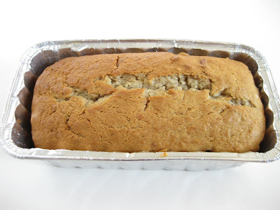 overhead photo of a loaf of banana nut bread in a loaf pan