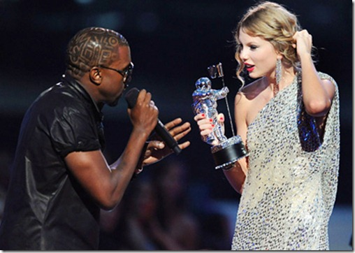 Kanye West takes the microphone from Taylor Swift and speaks onstage during the 2009 MTV Video Music Awards at Radio City Music Hall on September 13, 2009 in New York City. 2009 MTV Video Music Awards - Show Radio City Music Hall New York, NY United States September 13, 2009 Photo by Kevin Mazur/WireImage.com To license this image (16951148), contact WireImage.com
