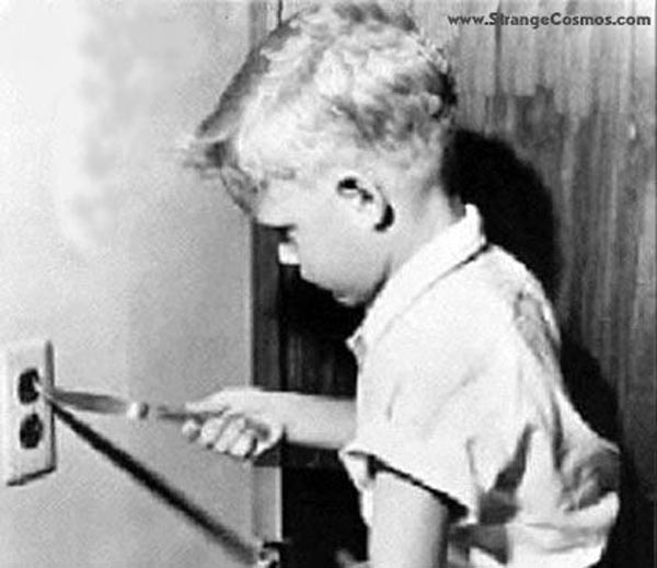 15 reasons why boys need strict parents - Boy putting knife into electric plug