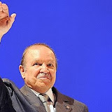 Algerian President Abdelaziz Bouteflika waves to his supporters during his last election meeting on April 6, 2009 in Algiers. Bouteflika, who at 72 is seeking to retain the top job for another mandate, won office in 1999 and was re-elected in 2004 with 85 percent of the votes. The presidential elections are scheduled for April 9, 2009. AFP PHOTO / PASCAL GUYOT