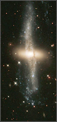 'Polar Ring' Galaxy NGC 4650A - A Disk of Red Stars Ringed By Dust, Gas, and More Stars.jpg