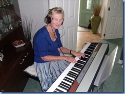 Eileen France trying out Peter Brophy's Korg SP250 digital piano