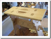 Trestle stool with carving
