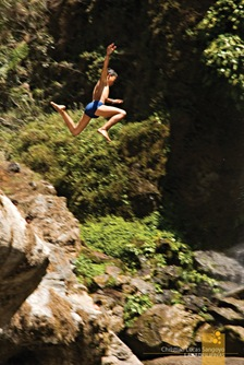Kids Jumping Down Into the Cool Pool Beneath Sagada's Bomod-Ok Falls