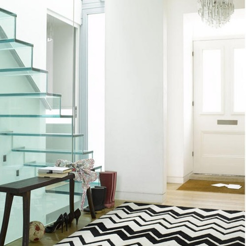 White bright airy hallway glass staircase black and white zig zag pattered rug front door L etc 09/2007 pub orig
