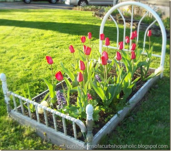 Plant flowers in a bed frame to create a true flower bed!