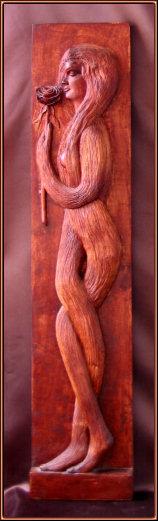 Dama de pelo. Talla en madera