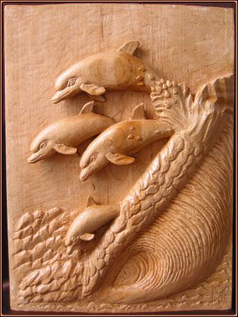 Delfines. Talla en madera