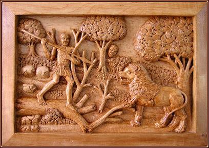 El ataque del león. Talla en madera