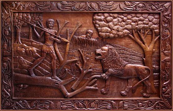El ataque del león 2. Talla en madera