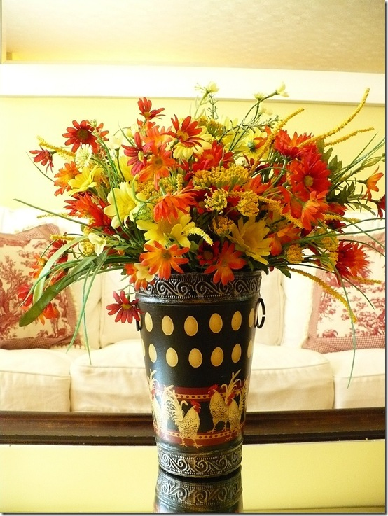 vase with faux summer flowers